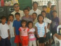 APO SOZA ALAS Member Bro. Chacha Albe with cleft lip patients.jpg