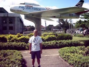 At my back is the plane of the first filipino pilot.JPG